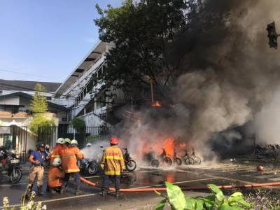 11 killed in 3 church bombings in Indonesia