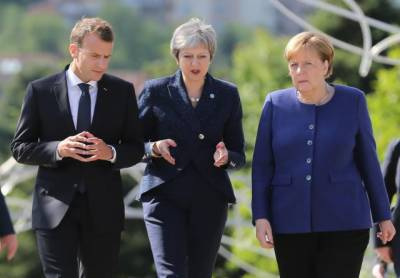 Britain's May agrees with France, Germany on upholding Iran nuclear deal