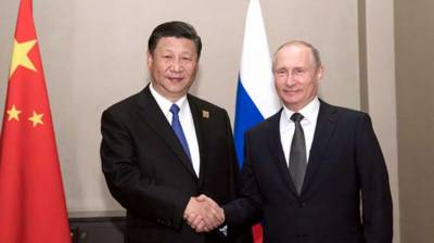 China says Putin's visit to enhance bilateral ties