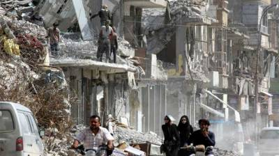 Evidence shows coalition attacks on Syria's Raqqa broke law: Amnesty