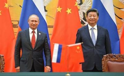 China Russia vow to further enhance strategic ties
