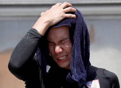 Heatwave blankets Japan, kills 14 people