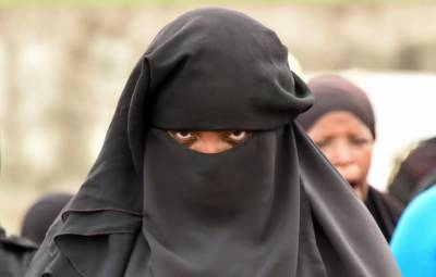 Man arrested for spying on wife wearing burqa