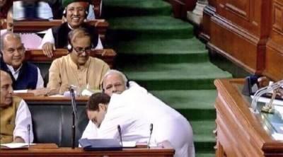Rahul Gandhi gives surprise hug to bitter foe Modi in parliament