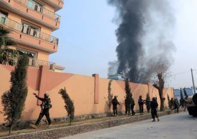 Gunmen storm government building after multiple explosions in Afghanistan