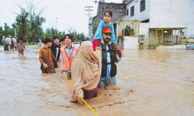 Flash floods in KPK render road blocked, suspension bridge washed away