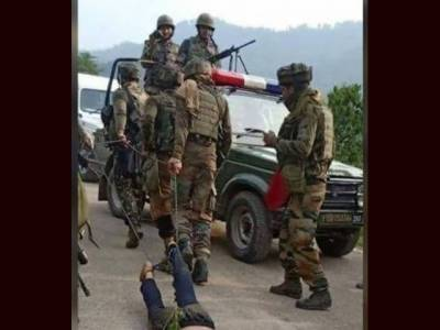 Indian Troops drag body of slain youth on road in IHK