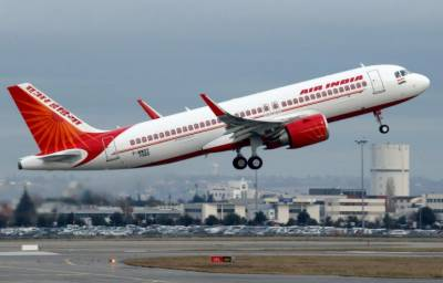 Air hostess falls out of Indian plane, suffers injuries