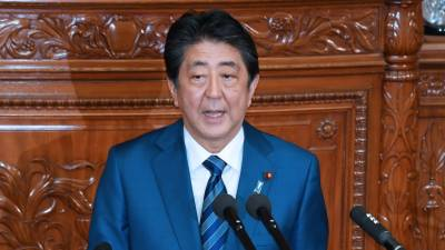 Japanese PM Abe vows to improve ties with China