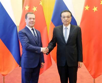 China, Russia agree to further enhance strategic political, economic &trade cooperation