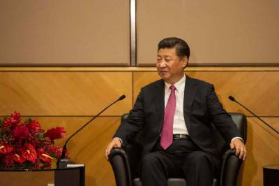 Xi, Merkel agree Iran issue should be resolved peacefully