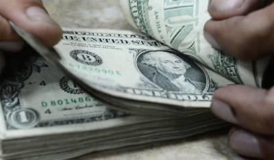Dollar gains 60 paisa in interbank, closes at Rs 158.48