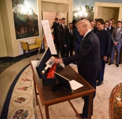 US President Donald Trump presents a gift to Pakistani PM Imran Khan