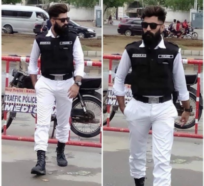Photos of handsome traffic police officer in Karachi goes viral on social media