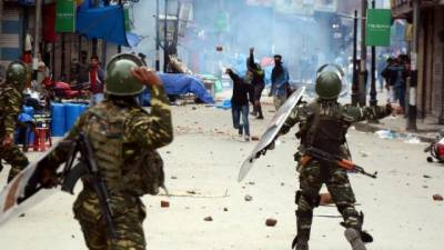 Dozens of Kashmiri protesters injured and arrested in clashes with Indian troops
