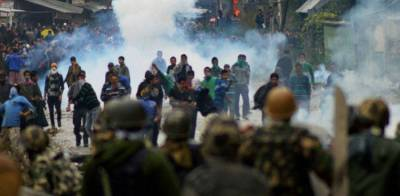 Indian troops fire tear gas shells and chilli grenades at protesting Kashmiris