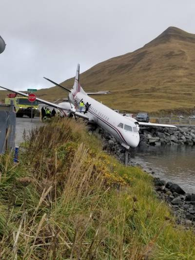 Passenger plane crashed into pond while landing