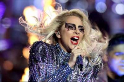 Singer Lady Gaga falls off the stage during live performance