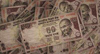 Indian Rupee falls against US dollar after economic outlook downgrade: Report