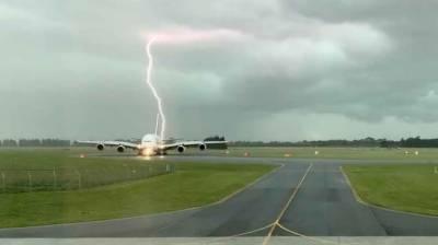 Lightning strikes near the passenger Aircraft on Runway