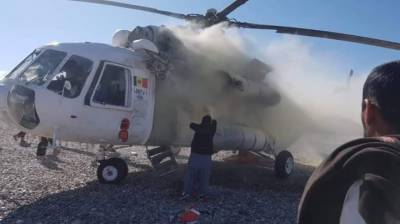 Army Helicopter hit with a Rocket, both pilots suffer injuries upon crash landing