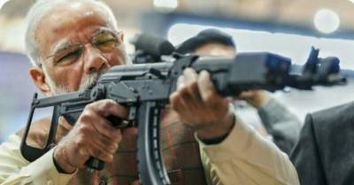 Indian PM Narendra Modi clicked taking Aim at enemy, Is It Pakistan?