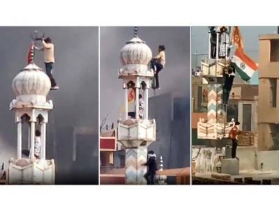 Extremist Hindus put Mosque on fire in New Delhi and raise Hindu flag on the mosque