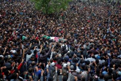 Thousands of people defying curfew participate in the funeral prayers of two martyred Kashmiri Youth
