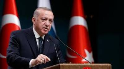 Erdogan shuts down university linked to rival