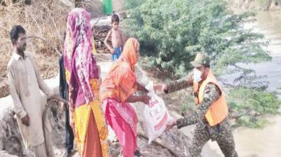 Pakistan Army, Navy continue relief operation in flood-hit Dadu August 12, 2020