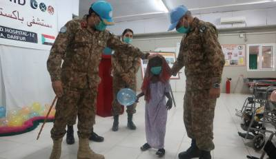 Pakistani peacekeepers help children in physio therapy program at Pakistani field hospital in Sudan