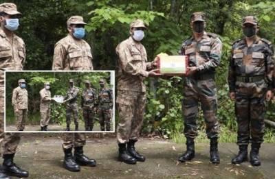 Pakistan India militaries exchange sweets on border on Eid ul Fitr